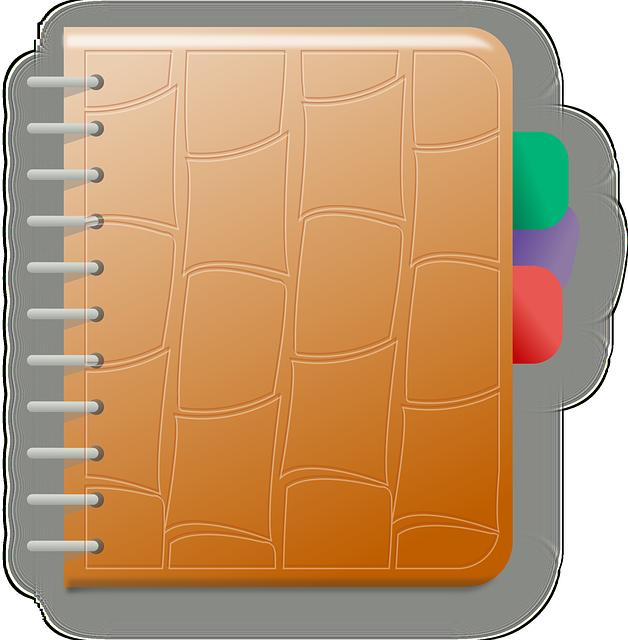 Un cahier avec une reliure en métal